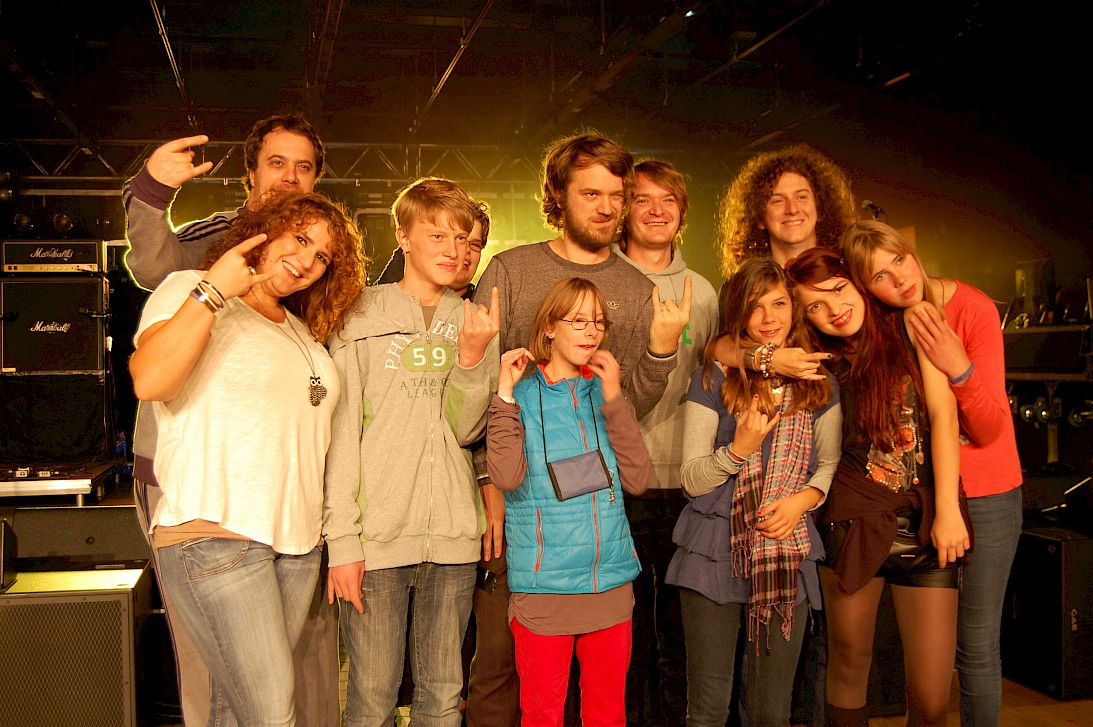 Kids pose with band Madsen