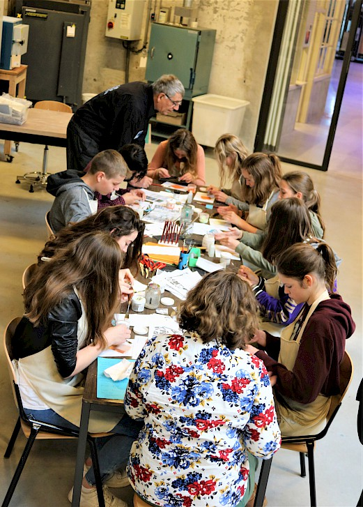 the picture shows young students painting